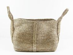 Jute Rectangle Basket  Jute basket handmade by women in Bangladesh. Perfect for storing toys, books and small linens. A fair-trade item that empowers underprivileged women by educating, learning new skills, creating leadership and employment to establish a harmonious/safe environment. 100% Jute.