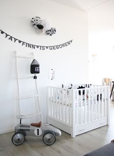 white nursery room in Scandinavian style contains white crib and white ladder White Nursery, Nursery Neutral, Nursery Room, Kids Bedroom, Aqua Nursery, Monochrome Nursery, Bedroom Decor, Bedroom Lighting, Modern Bedroom
