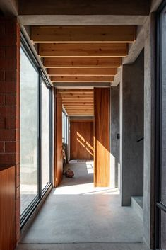 A Stoic Structure in Oaxaca Gives Way to a Couple's Convivial Home #dwell #moderndesign #hometours #oaxaca #hallways Small Town Names, Brick Facade, Concrete Structure, Exposed Beams, Stone Houses, Prefab Homes, Furniture Layout, Living Room Modern, Bay Window
