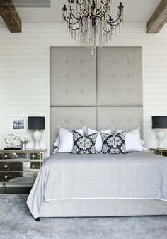 Comfy, cozy bedroom nook with gray built-in headboard flanked by tall cabinets, creamy white bedding and black & white striped pillow. Description from decorpad.com. I searched for this on bing.com/images
