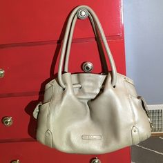 Cole Haan Handbag Beautiful Cole Haan handbag with dust cover, pale silver in color. Great condition. Cole Haan Bags