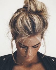 Image result for blonde streaked hair with dark roots in messy bun