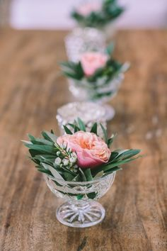 small flowers centerpiece for cocktail tables glass with rose and olive tree leaves