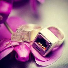Geekette Bits' ... Some friend had these Ethernet plug and port temporary wedding bands made for their special day. Call us geeky, but these impressed us much more than the typical wedding band or engagement ring.