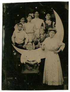 Early tintype of large family on a crescent moon