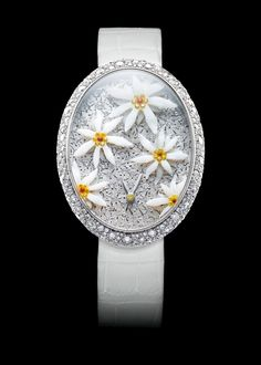 Edelsnow is an exquisitely crafted fresh and delightful ladies' timepiece. The iconic Edelweiss gleams within its this frosty Alpine miniature world. Yellow Diamonds, Orange Sapphire, Art Watch, Gold Set, Art Pieces, Jewelry Watches, White Gold, Bling, Fancy