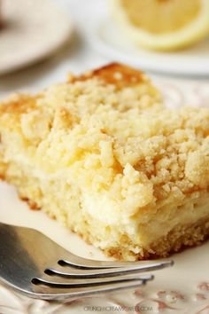 Lemon Cream Cheese Crumb Cake - fluffy lemon cake with a creamy cheesecake layer and a crumb topping. #recipe #cake #lemon crunchycreamysweet.com