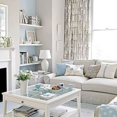 White bright airy blue living room