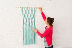 Follow this tutorial to make a macrame wall hanging.