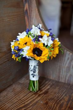 wedding bouquet of sunflowers yellow white blue...Flowers of Charlotte loves this!   Find us at www.charlotteweddingflorist.com