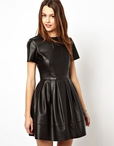ASOS Skater Dress In Leather Look. Made from a leather-look fabric. Made from a leather-look fabric. Crew neckline. Flattering, high waist. Zip fastening to reverse. Fabric: 100% Polyester. Hand Wash Only. €24.58