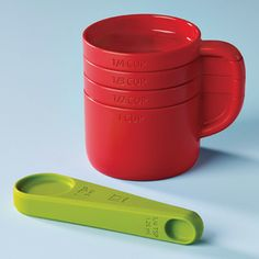 Cuppa Measuring Cups & Dash Measuring Spoon by Umbra®. Measuring cups fit together to form a cup form.Saves space.