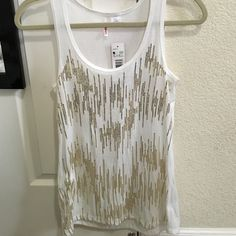 Cute white tank with gold sequence New / with tag ,white tank with gold  sequence. Available in black ( new / no tags) . Both size S . Both for $14 BONGO Tops Tank Tops
