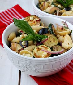 This pasta salad is heavy on summer vegetables (corn and zucchini) and gets a bit of a kick from red pepper flakes. It's a great alternative to potato salad and will be a perfect meatless entree or side dish for your next picnic or family potluck.