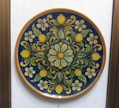 """Ceramic dish of Caltagirone modeled on a lathe to """"wave"""" with floral decorations…"""