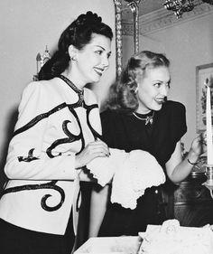 Ann Miller and Linda Darnell prepare for Ann's baby shower, 1946