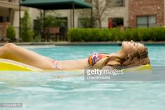 fad024ec9 View Stock Photo of Mixed Race Girl In Bikini On Raft In Swimming Pool.  Find premium, high-resolution photos at Getty Images.
