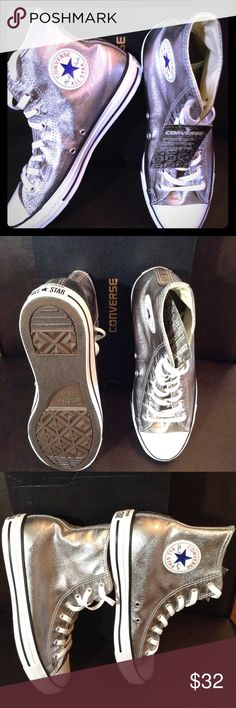 Converse All Stars Unisex Convers All Stars are featured in a gunmetal color with a white and black sole. Sneakers are high-tops shoelace front with side and heel logo. Converse Shoes Sneakers