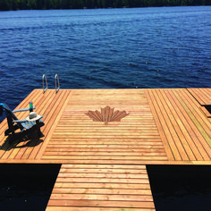 Nadire Atas Lakeside Living This article was originally published in the Early Summer 2016 issue of Cottage Life magazine. When Upper Harris Lake, Ont., cottager Ed Boekestyn built his new dock, he put his patriotism on full. Lake Cottage, Cottage Living, Cottage Homes, Cottage Grove, Lakeside Cottage, Lake Cabins, Cabins And Cottages, Life Magazine, Construction Chalet