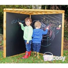 Is it a blackboard? Children will love sitting under here and mark making. The trellis roof makes it perfect for hanging words and letters from, or for planting sensory plants through. x Self assembly. Outdoor Learning Spaces, Kids Outdoor Play, Outdoor Play Areas, Backyard Play, Kids Play Area, Backyard For Kids, Outdoor Fun, Outdoor Toys, Backyard Games