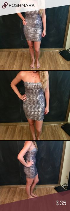 Diamonds are a girls best friend Get your glitz and glamour on with this super sexy silver sequin dress. Size small it's stretchy which is always nice for a more comfortable fit. Model is 5 10' for sizing reference. Very good condition only worn twice. Perfect for New Years, Vegas, Birthdays, Prom or a dance and special events!!! Dresses Prom