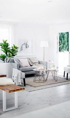 Beautiful white living room decoration with a white sofa, cushion & pillows and also there has a wall canvas art gallery and white & gray rugs as well as other elegant accessories. It's a modern and classic interior living room decoration idea. http://www.urbanroad.com.au/
