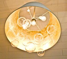 Pudel-design: DIY bubble chandelier from IKEA Lampshade!----plastic clear ornaments, gold leaf and, bulb holder/ light fixture. Wrap cord with sisal rope. ( ribbon?)
