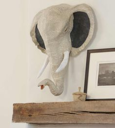 Elephant paper mâché head. Yeah another choice. I like a trio of heads myself. Place them in a play room, office or family room. They will add a bit of whimsy to any children's space, and to an adult space a bit of mystery and hmmm maybe a hint of a masculine touch.