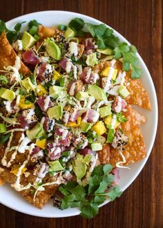 Wonton nachos topped with ahi tuna, mango, avocado, and green cabbage. Nacho night will never be the same again...