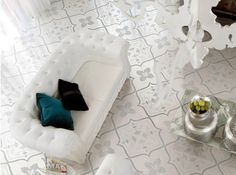 Tile with carpet inspired designs turns an average living area into something special.
