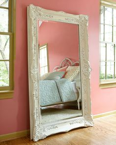 """Antiqued resin frame. Beveled mirror. D rings on back for hanging. Hangs vertically and horizontally 42""""W x 5""""D x 67.5""""T. Imported."""