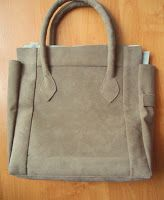 Bags you can make: Tutorial: How I Made a Bag from a Jacket.  I am thinking of cutting up a leather jacket that I no longer wear and doing this with it.