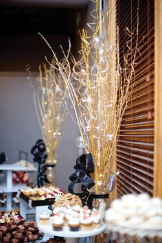 Tall, gold centerpieces perfectly complemented the city feel. #goldcenterpiece #weddingdecor
