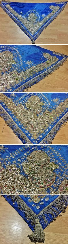 Woman's traditional bridal/festive 'arkalık' (or 'zibba' = waist cloth, generally worn on the backside). Late-Ottoman 'Rum' (Anatolian Greek), from Sille (near Konya), ca. 1900.  Blue silk, adorned with golden metallic thread embroidery, with 'telkırma'(folding thin silver slat into the fabric), patch-work, small mica flowers & leaves, and silvery metallic sequins.  Edged with golden metallic thread fringes and a large tassel.