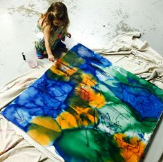 wee warhols painted this stretched bed sheet canvas using liquid watercolor and sharpie .  Then they used droppers to add rubbing alcohol to make the colors bleed.  art artclass austin street art graffiti ece  masterpiece