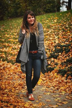 Tieka of Selective Potential:recreate her look w Cabi f 13 multi topper. Charcoal tucked tunic and the ink ruby jeans