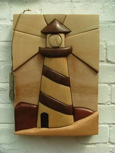 Intarsia lighthouse, wood, carving, art, made by students at www.rowanhumberstone.co.uk