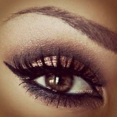 Gold with defined creased eye makeup  this is perfect for me since i have brown eyes (: