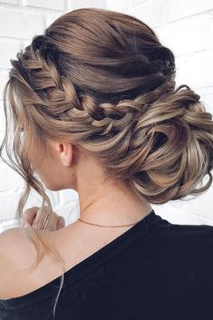 mother of the bride hairstyles low bun with braided halo and loose curls mpobedinskaya