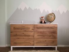 This TARVA dresser in a baby's nursery is anything but ordinary. - Ikea DIY - The best IKEA hacks all in one place Ikea Malm, Ikea Dresser Hack, Ikea Tarva Dresser, Nursery Dresser, Ikea Hack Nursery, Dresser Ideas, Wood Dresser, Nursery Rugs, Ikea 5 Drawer Chest