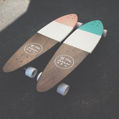 A longboard with wood showing on top and also some kind of design