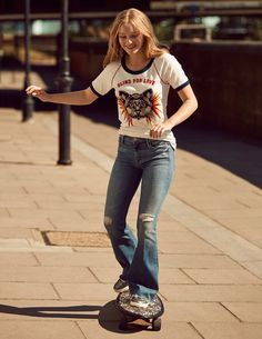 Maddi Waterhouse skateboards in Gucci t-shirt, MOTHER Denim jeans and Topshop sneakers. Photo: Jason Kim