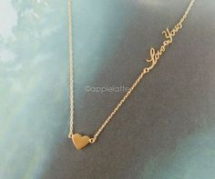 heart necklace with love you letters in gold, silver, pink rose gold on Etsy, $12.80
