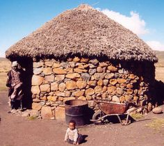 This photo from Thaba-Tseka, North is titled 'boy next to Lesotho traditional house'. African Hut, African Tribes, Vernacular Architecture, Architecture Design, See Think Wonder, South Afrika, Natural Structures, Thatched House, Contemporary Quilts