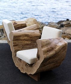 Half cut & hollowed out log chair sanded smooth on top and around sides.