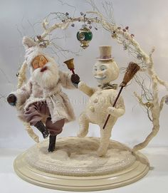 Snowman and Santa dancing in the snow by artist Scott Smith of Rucus Studio. Photo Courtesy of: Scott Smith/Rucus Studio.
