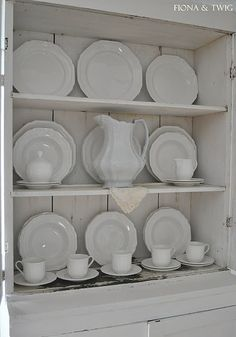 Love this white hutch with white dishes.