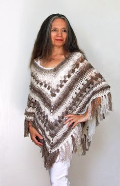 Make this beautiful boho poncho with Lion Brand Scarfie! Pattern by Bernadette Prokopetz.