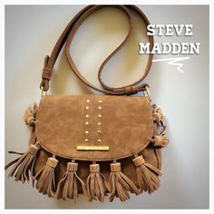 Cognac Boho Saddle Bag~ also available in Black! Leather Fringe ~ NWT.  Cognac Boho Saddle Bag approx 8.25w X 10.5h and long  adjustable strap.  Also available in black! Steve Madden Bags Crossbody Bags