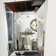 Stunning beveled mirror designed and made by Roberto G. Rida in Milan. This mirror stands out because of its peculiar shape and draws attention to the beauty and quality of Rida's technique.